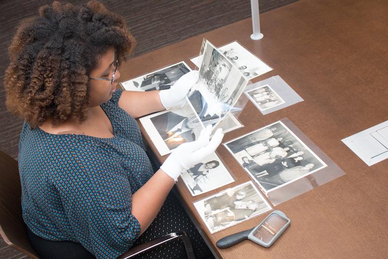 archivist with historic photos