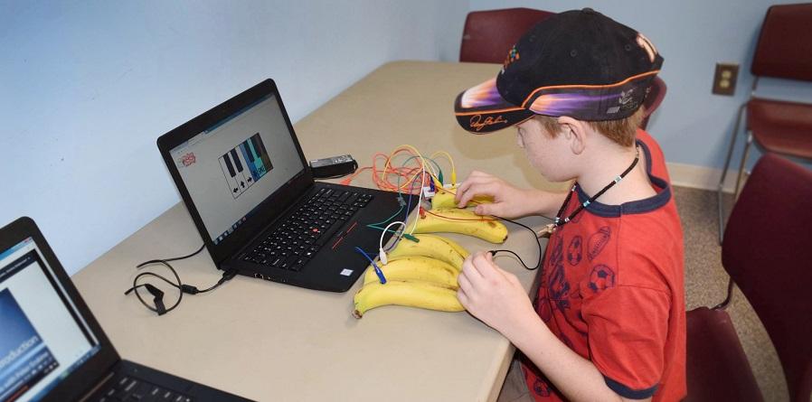 boy exploring makerspace tools