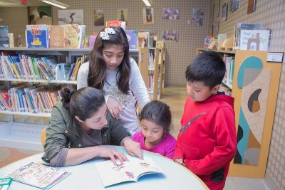 family reading at prime time dekalb tucker library