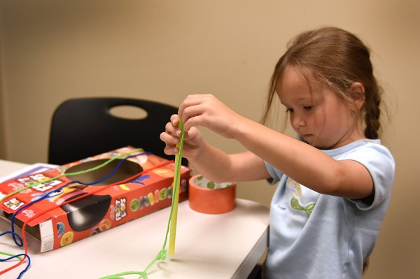 young girl in library makerspace