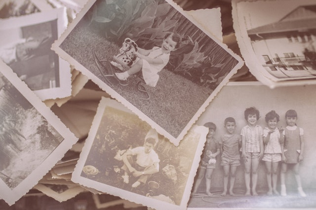 stack of black and white photos of children