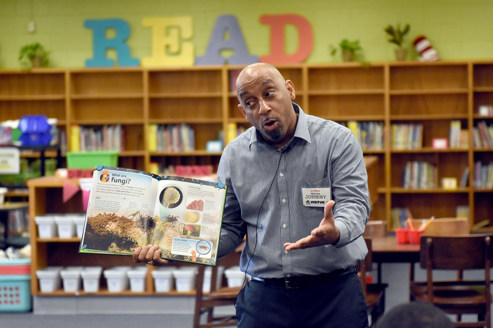 Volunteer Johnny Rodriguez reads to participants of the Guy's Read program through Chattahoochee Valley Libraries.