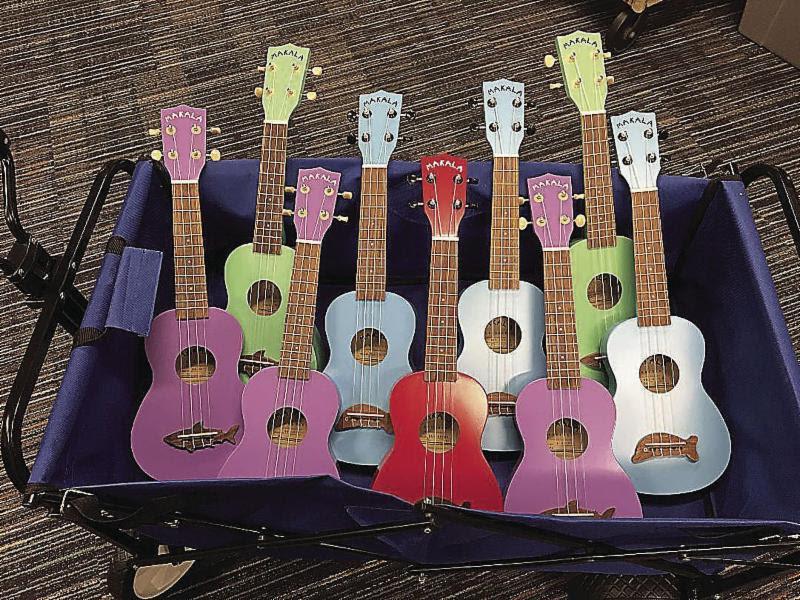photo of a wagon full of ukuleles