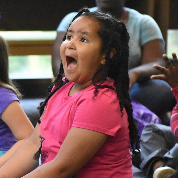 excited girl at a summer reading library event