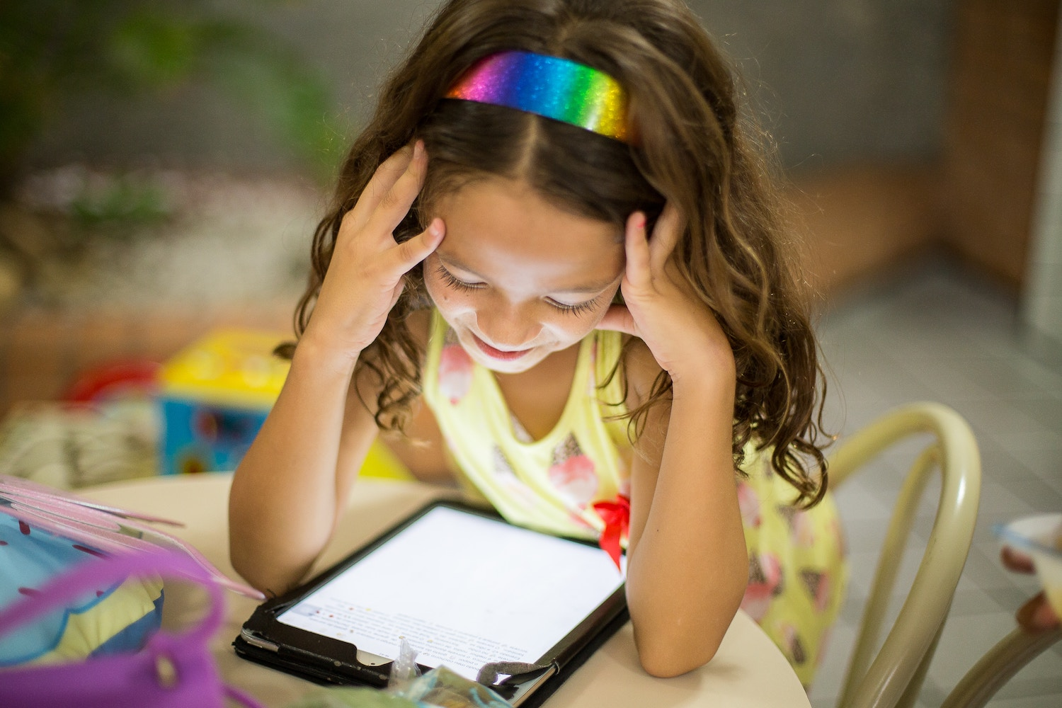 girl reading with tablet