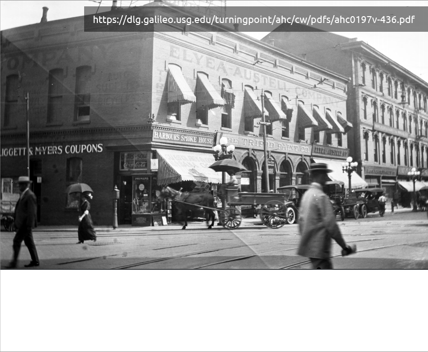 black and white image of a department store and people walking down the street