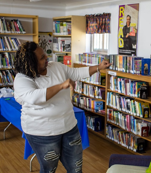library manager posing with library collection