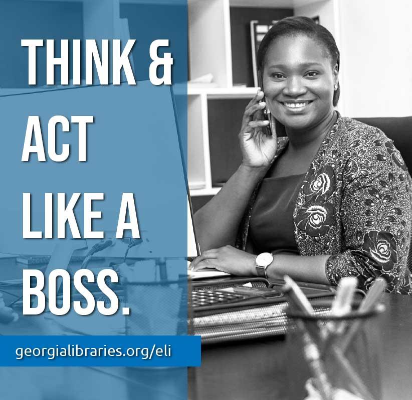 female entrepreneur sitting at a desk