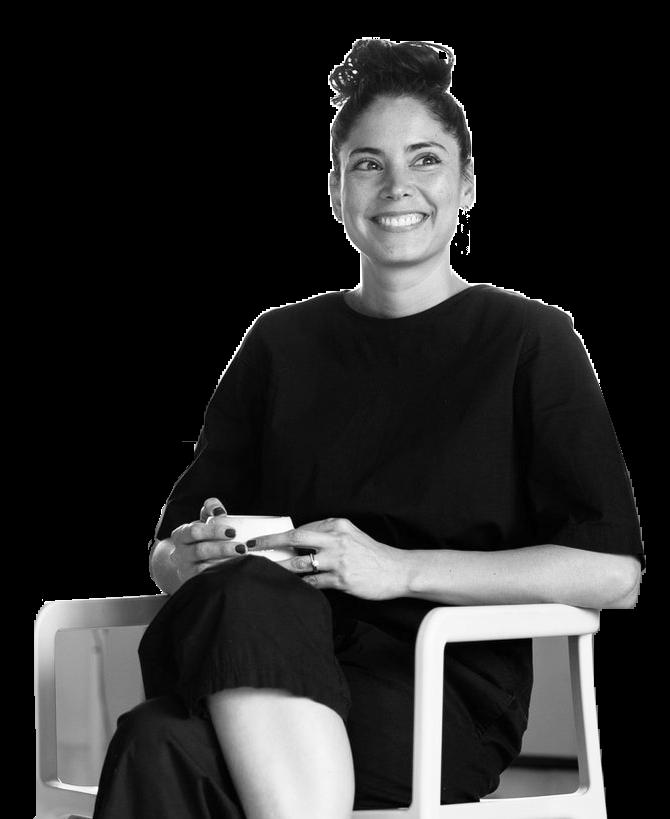 photo of female entrepreneur sitting in chair
