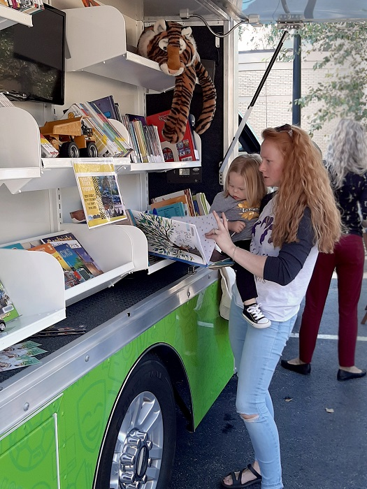 family using library bookmobile