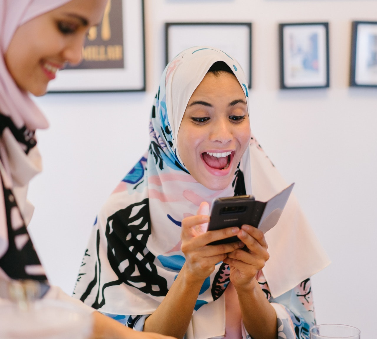 excited lady using smartphone