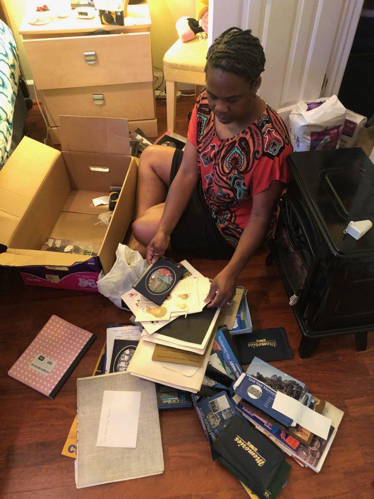 woman sorting through a box of photographs