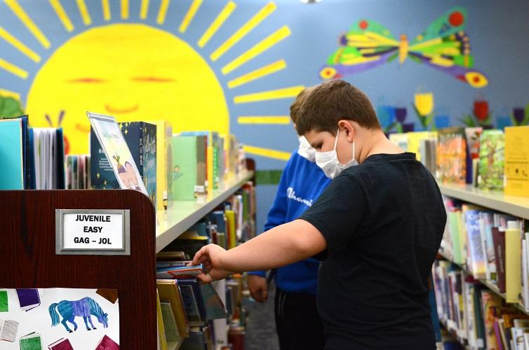 student browsing books