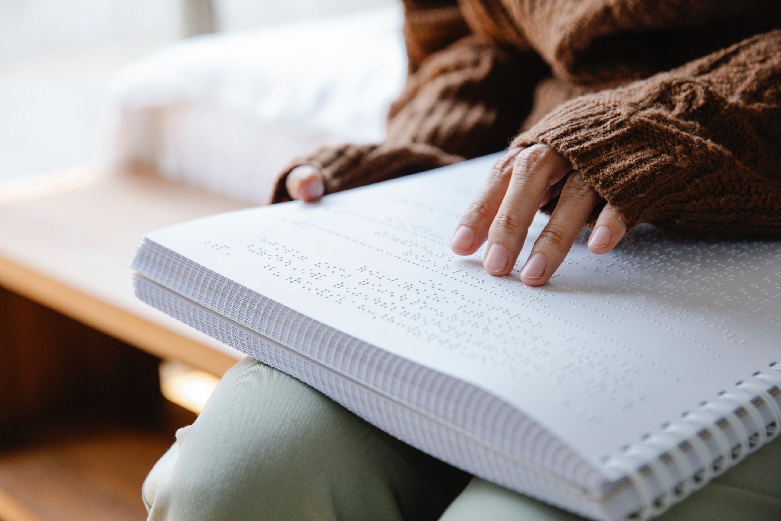 person reading braille page