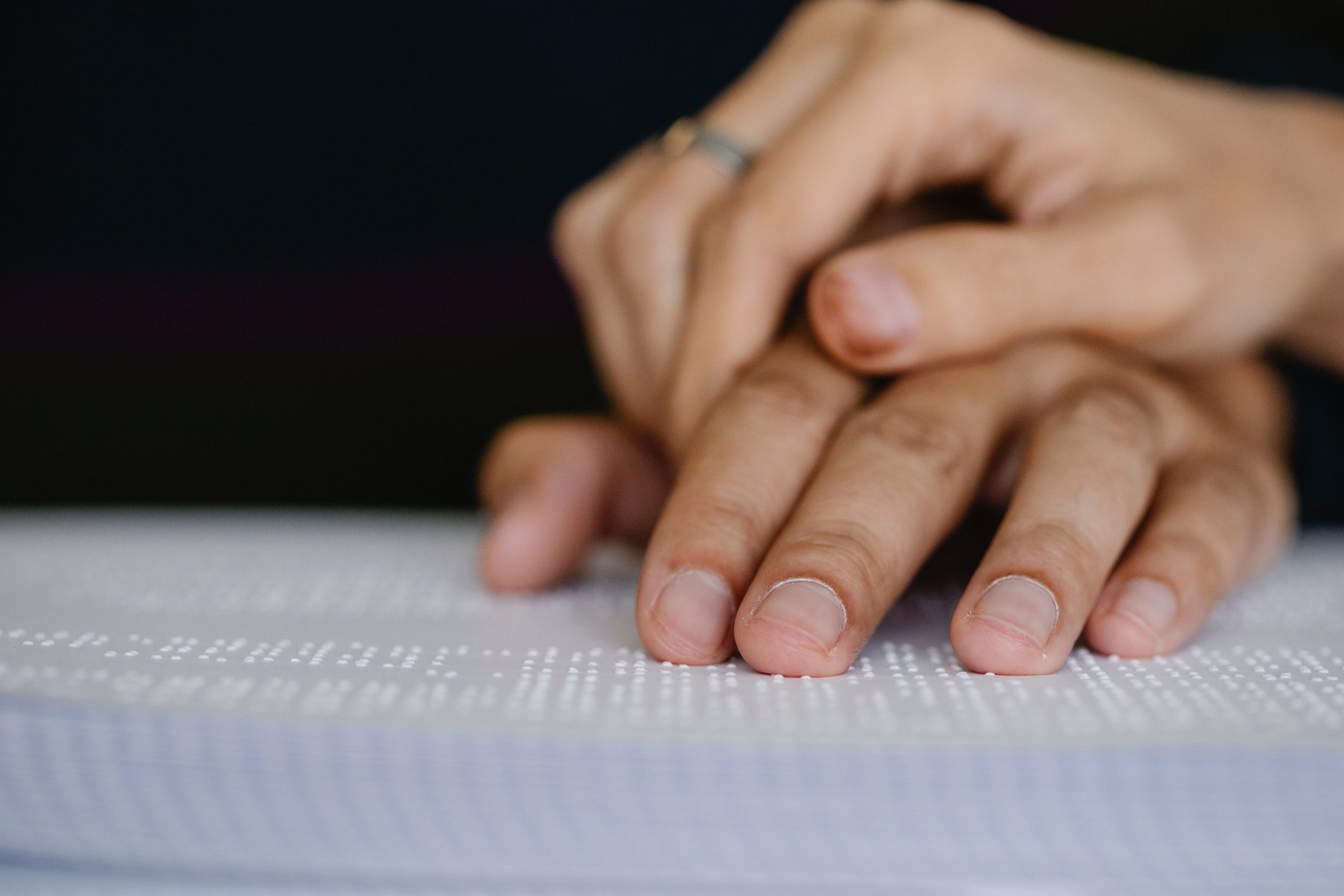 person reading braille book
