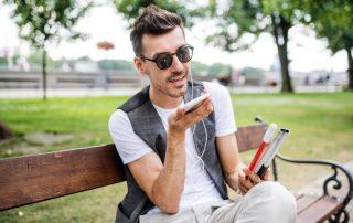 visually impaired man using smart phone